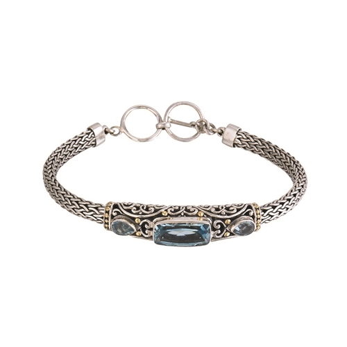 "SS 18 KARAT BALI DESIGN BRACELET WITH 7X14mm (CENTER) AND (2) 4X6mm BLUE TOPAZ - ADJ TO 8"" WITH TOGGLE LOCK"